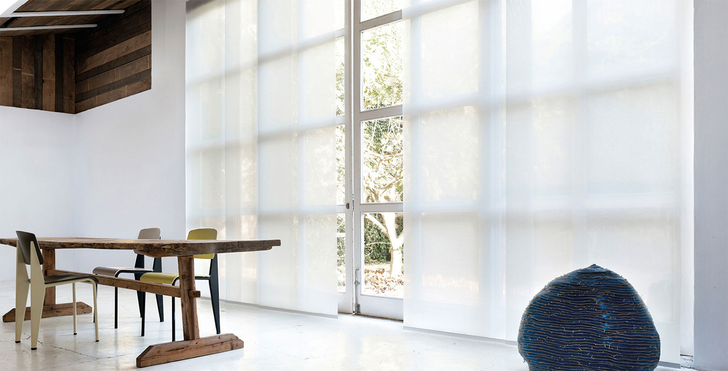 Based in The Netherlands, Coulisse crafts beautiful window treatments like the panel blinds pictured here.